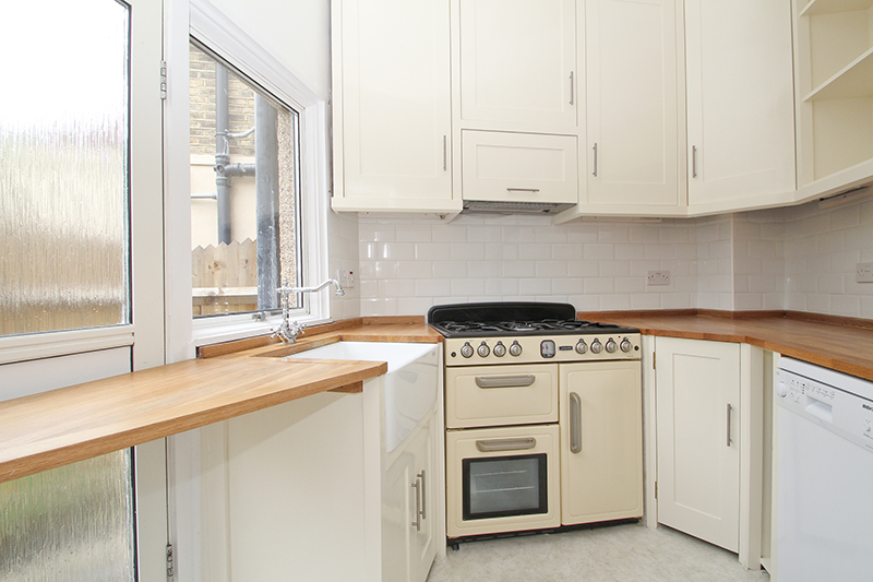 small irregular shaped kitchen - Jennings-Bramly Furniture Ltd